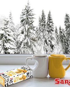 66636635 - two cups of coffee on a windowsill. in the background, a beautiful winter forest in snow